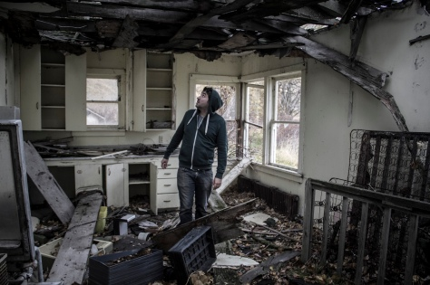 Johnny in one of the abandoned outbuildings.