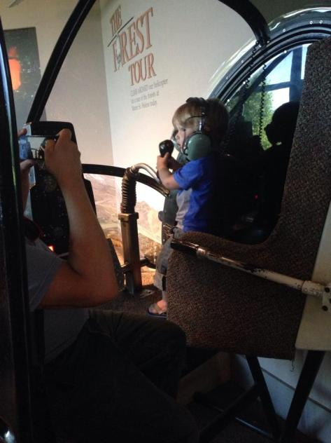My nephew Gideon in the helicopter simulator in the Forest Learning Center